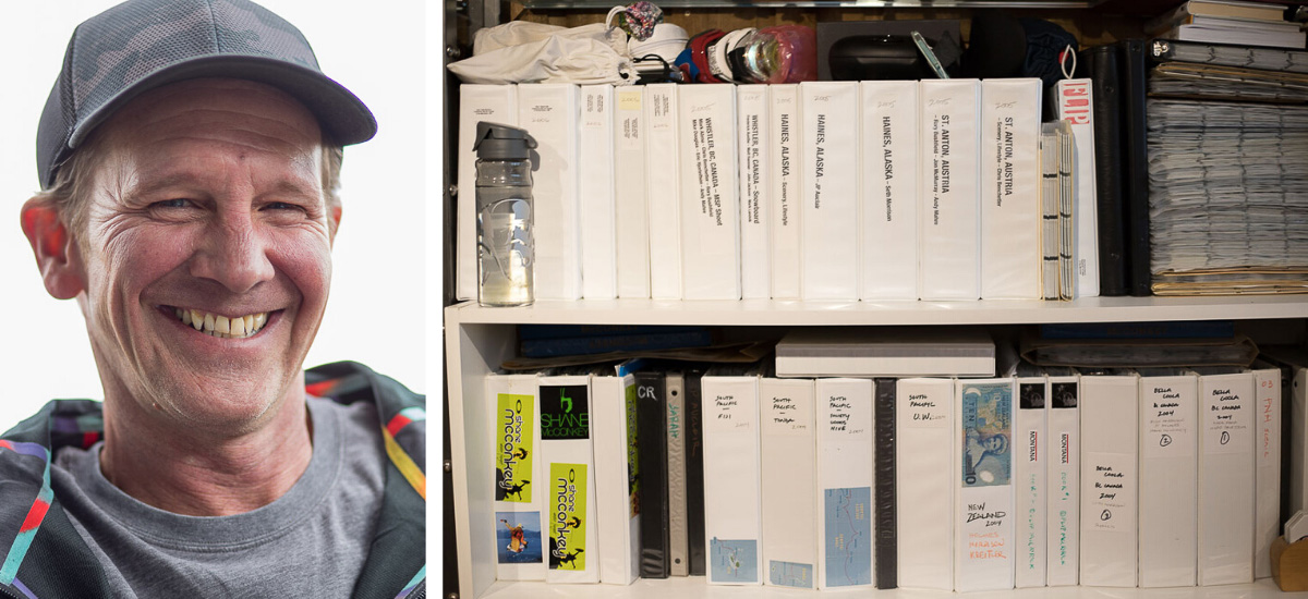 Photographer Flip McCririck + his binders of photos in his office in Colorado