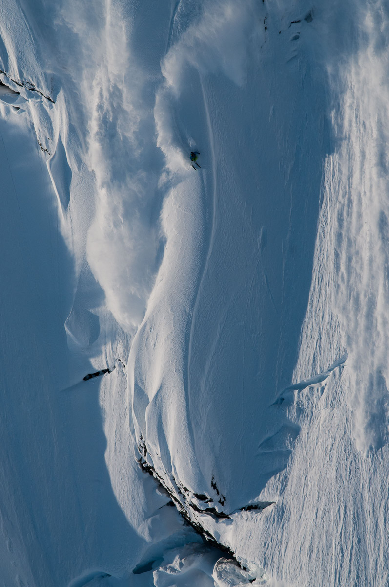Sage Cattabriga-Alosa skis a crazy looking Alaskan line in Haines. I was a junkie for pulling the doors and shooting from the helicopter. We were the drone. Maybe someday I will own one. —Flip McCririck