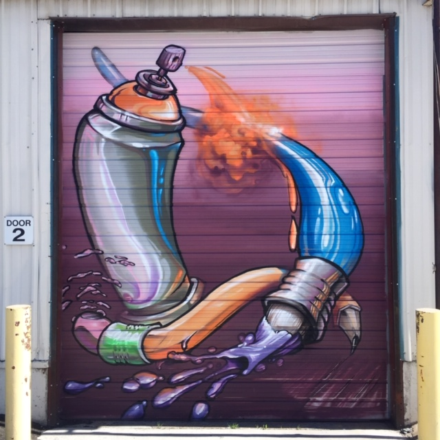 I love working in digital art. This was a study I was doing with the tools I often use. Once the design work was done it was easy to transfer to a larger scale with spray paint on this roller door. —Robin Munro